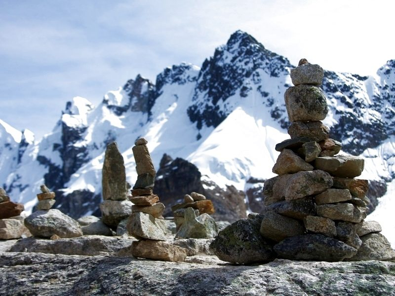 optimized_Peru_-_Salkantay_Trek_065_-_cairns_on_the_pass__7154610823___1_